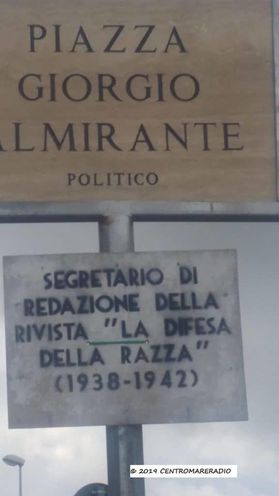Piazza Almirante, sotto il cartello compare scritta provocatoria